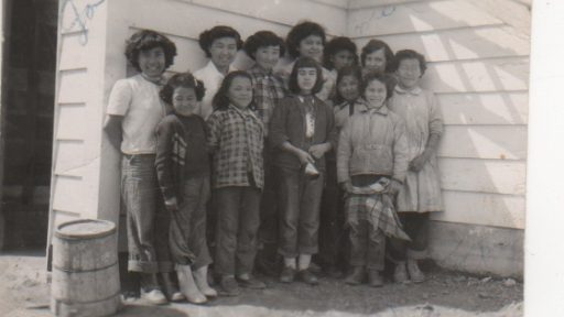 Dorthy and friends standing in front of the original school [now Wood River Camp next door to the lodge]